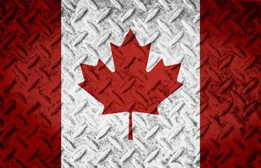Canada flag layered over steel diamond metal plate. Worn diamond plate surface with dirt and grit.