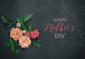 Happy Mother's Day holiday banner with text and floral style arrangement on chalkboard background.