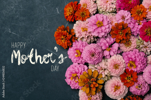 Zinnia flowers in group with Mother's Day text on chalkboard background for holiday graphic.