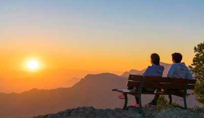Romantic scene of couple watching sunrise.