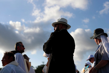 Catholics are seen before the holy mass for the opening of World Youth Day at the Coastal Beltway in Panama City