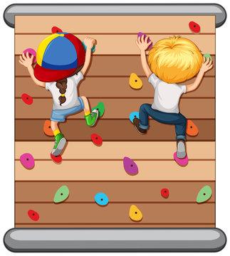 Children climbing the wall
