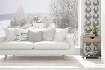 White stylish minimalist room with sofa and winter landscape in window. Scandinavian interior design. 3D illustration