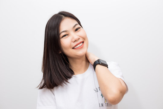 Smiling asian women with smart watch sitting on white background