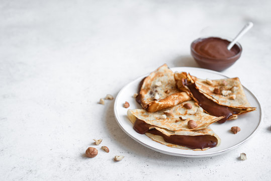 Crepes with chocolate and hazelnuts