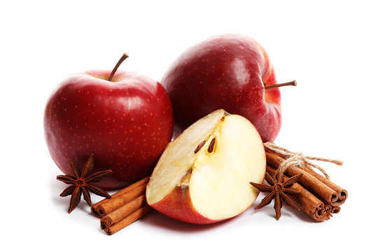 Juicy ripe apples with cinnamon and star anise isolated on white background. Ingredients for mulled wine.