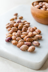 Raw Dry Pinto Beans on Marble Board / Kidney Beans.