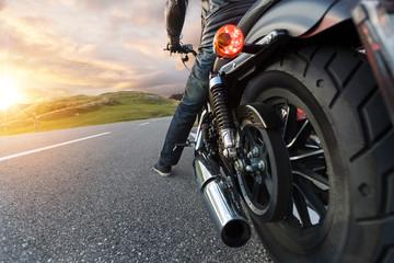 Detail of motorcycle driving in Alpine road