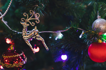 close up of Christmas prop that hang on a tree like reindeer plastic and ball