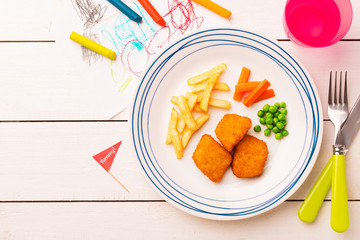 Kid's meal (dinner) - chicken nuggets, fries, carrot and green peas