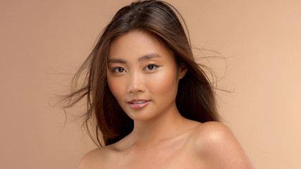 thai asian model slightly smiling with hair blowing