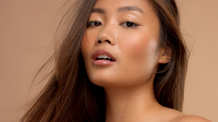 asian model with slightly open mouth