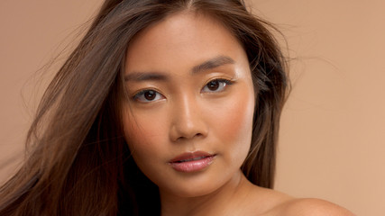 straightly watching to the camera asian thai japanese model. Closeup portrait natural looking asian model