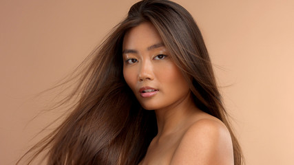 asian model with soft focus moving her hair