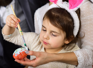 Egg hunt on spring holiday. Little girl with parents paint easter eggs. Family love easter. Happy easter. Childhood. Rabbit family with bunny ears. Funny bunny. Easter is coming