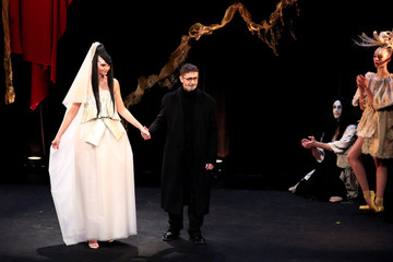 Designer Franck Sorbier appears with a model at the end of his Haute Couture Spring-Summer 2019 collection show in Paris