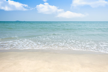 Beach sand with sea wave and sky background and summer day
