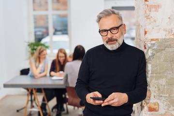 Senior businessman staring at the camera