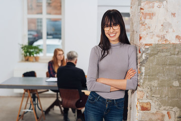 Relaxed happy young woman in an office