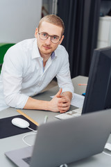 Young businessman staring intently at camera