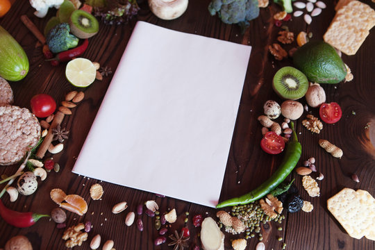 the clean sheet a4 lies on a kitchen table (menu mock up)