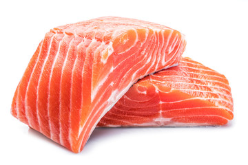Fresh raw salmon fillets on white background.