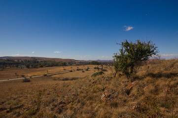 View over the country in South Africa with a clear blue sky