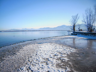 Coast line on the Fraueninsel at the Chiemsee (Bavaria) in Winter with the alps in the background