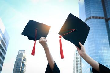 Students holding a graduation cap Glad to graduate