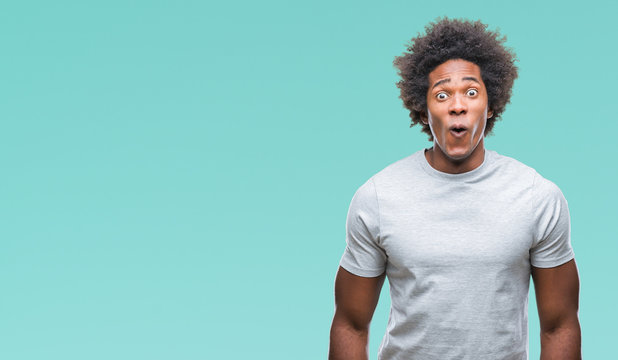 Afro american man over isolated background afraid and shocked with surprise expression, fear and excited face.