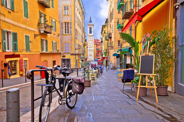 Foto op Plexiglas Europa Nice colorful street architecture and church view