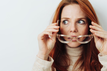 Attractive woman removing her glasses