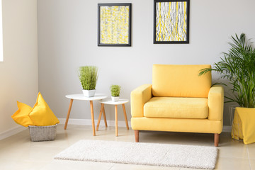 Interior of modern room with comfortable armchair