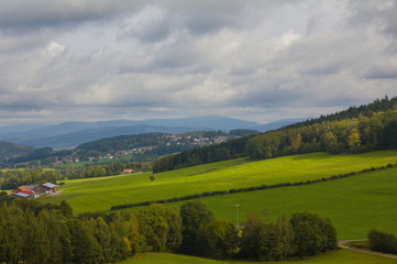 View over hills in the Bavarian forest with cloudy sky