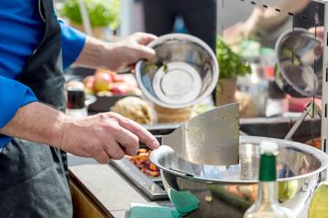 Keuken foto achterwand Koken Chefs at work in a restaurant kitchen making delicious food