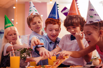 Group of kids visiting birthday party of their classmate