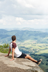 Resting sportsman looking at view