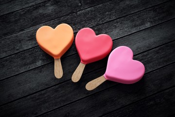Three heart-shaped ice creams in pink colors