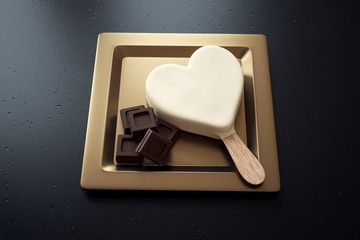 White chocolate ice cream with a heart shape and chocolate ounces on a plate