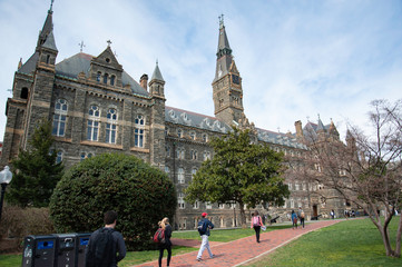 College students walk across the historic campus of Georgetown University.