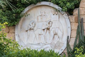 Yasmine Hammamet, TUNISIA - JULY 26 2018: The decorated wall with an army of war elephants, Yasmine Hammamet, Tunisia, Africa