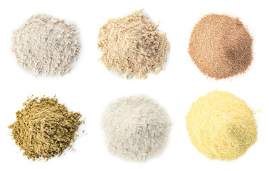 Set of different organic flour on white background, top view