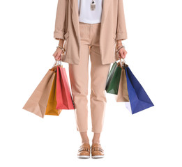 Young woman with shopping bags on white background, closeup