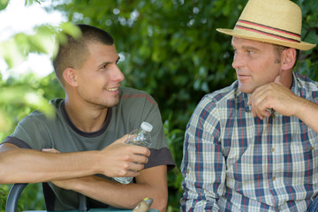 two agricultural workers taking a break