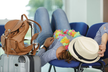 woman sleeping at airport