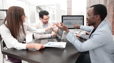 business team analyzes the financial data