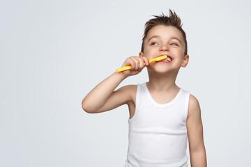 Adorable kid brushing teeth