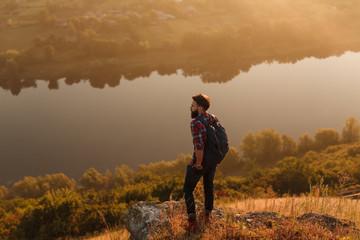 Bearded guy standing near river