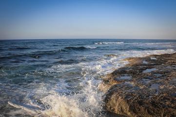 beautiful deserted landscape rocky seashore, blue waves
