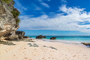 Rock formations and the sandy beach at Horseshoe Bay, on the island of Bermuda